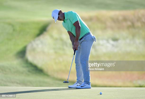 Brooks Koepka of the United States putts on the 18th green during the final round of the 2017 US Open at Erin Hills on June 18 2017 in Hartford...