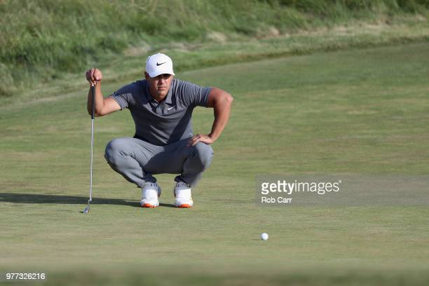 Brooks Koepka of the United States putts on the 18th green during the final round of the 2018 US Open at Shinnecock Hills Golf Club on June 17 2018...