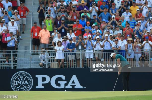 Brooks Koepka of the United States putts on the 18th green to win the 2018 PGA Championship with a score of 16 at Bellerive Country Club on August 12...