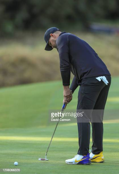 Brooks Koepka of the United States putts on the par 4 13th hole wearing a special pair of 'Mamba' golf shoes to remember Kobe Bryant during the first...