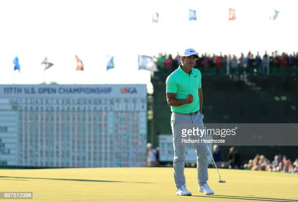Brooks Koepka of the United States reacts after finishing on the 18th green during the final round of the 2017 U.S. Open at Erin Hills on June 18,...