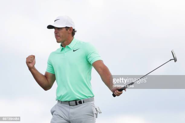 Brooks Koepka of the United States reacts after making a birdie on the eighth green during the final round of the 2017 US Open at Erin Hills on June...