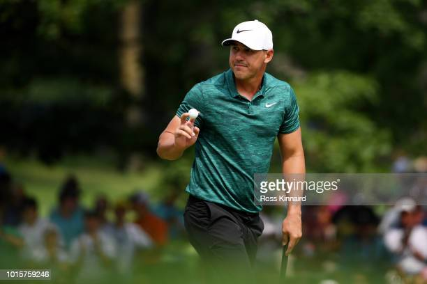 Brooks Koepka of the United States reacts after making a par on the sixth green during the final round of the 2018 PGA Championship at Bellerive...