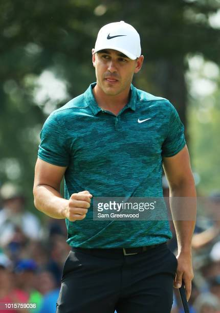 Brooks Koepka of the United States reacts after making a putt for birdie on the ninth green during the final round of the 2018 PGA Championship at...