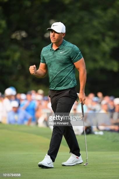 Brooks Koepka of the United States reacts after making a putt for birdie on the 16th green during the final round of the 2018 PGA Championship at...