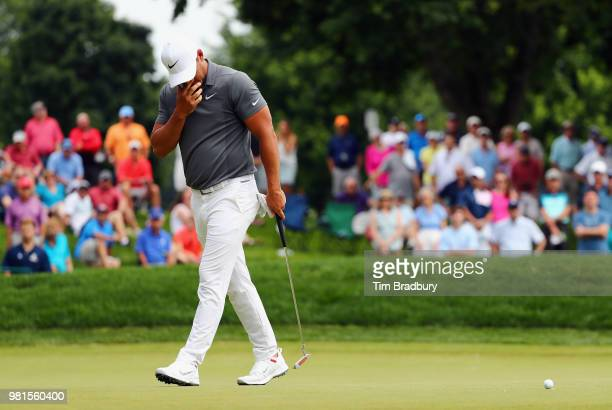 Brooks Koepka of the United States reacts after missing a putt on the seventh green during the second round of the Travelers Championship at TPC...