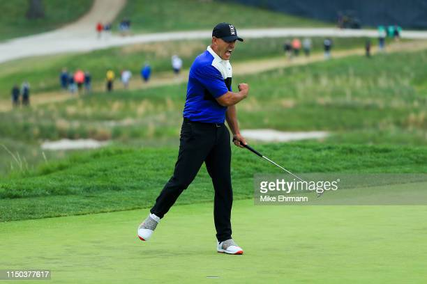 Brooks Koepka of the United States reacts after putting in to win on the 18th green during the final round of the 2019 PGA Championship at the...