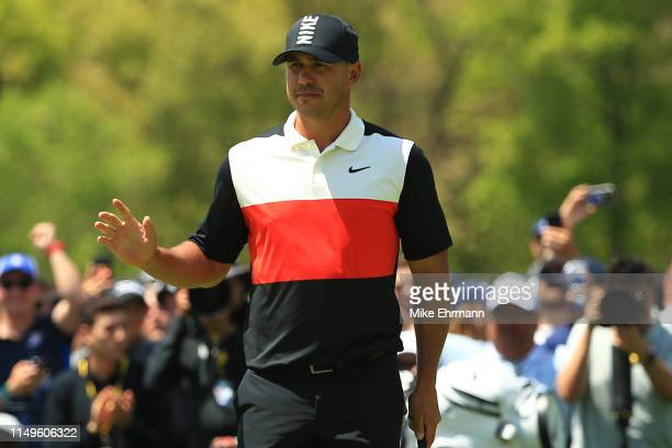 Brooks Koepka of the United States reacts on the ninth green during the first round of the 2019 PGA Championship at the Bethpage Black course on May...