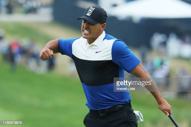 Brooks Koepka of the United States reacts to his putt on the 18th green during the final round of the 2019 PGA Championship at the Bethpage Black...