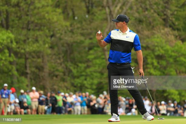 Brooks Koepka of the United States reacts to his putt on the fourth green during the final round of the 2019 PGA Championship at the Bethpage Black...