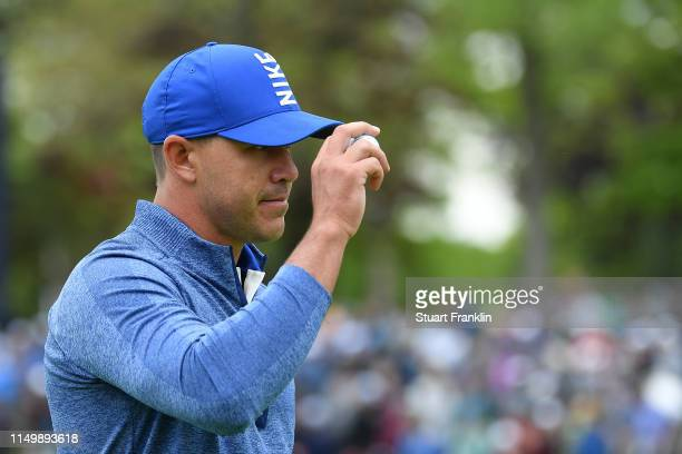 Brooks Koepka of the United States reacts to his putt on the second green during the second round of the 2019 PGA Championship at the Bethpage Black...