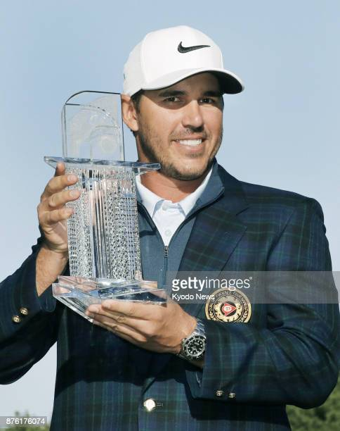 Brooks Koepka of the United States shows off the trophy after winning the Dunlop Phoenix golf tournament at Phoenix Country Club in Miyazaki on Nov...