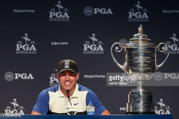 Brooks Koepka of the United States sits alongside the Wanamaker Trophy as he speaks to the media during a press conference after winning during the...