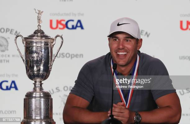 Brooks Koepka of the United States speaks to the media after winning the 2018 US Open at Shinnecock Hills Golf Club on June 17 2018 in Southampton...