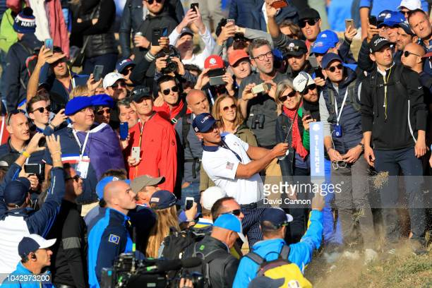 Brooks Koepka of the United States Team plays his second shot on the 17th hole in his match with Dustin Johnson against Justin Rose and Henrik...
