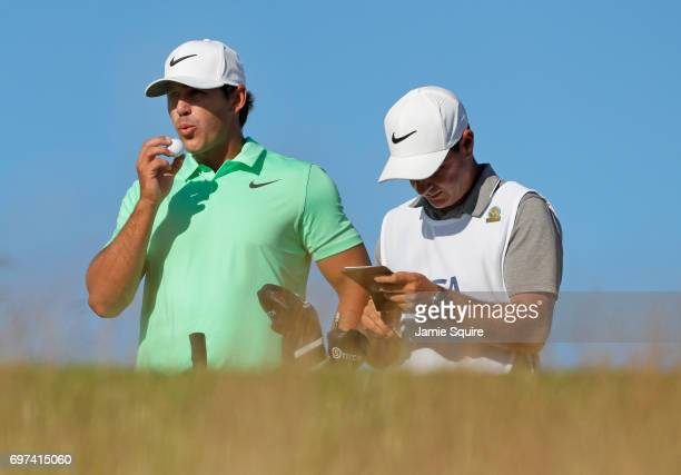 Brooks Koepka of the United States waits to play his shot from the 15th tee during the final round of the 2017 US Open at Erin Hills on June 18 2017...