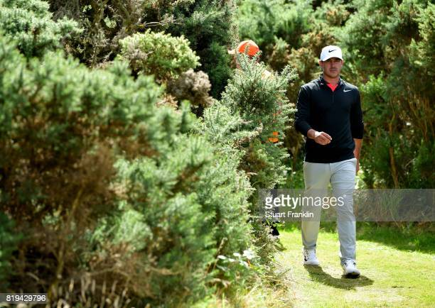 Brooks Koepka of the United States walks through the bushes on the 18th hole during the first round of the 146th Open Championship at Royal Birkdale...