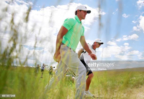 Brooks Koepka of the United States walks to the first tee during the final round of the 2017 US Open at Erin Hills on June 18 2017 in Hartford...