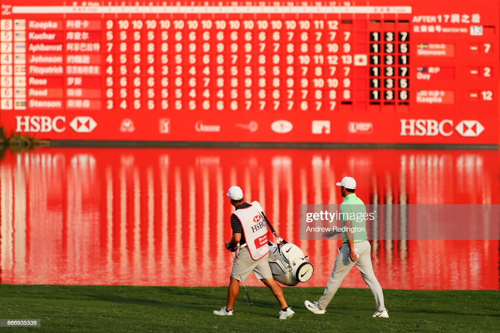 Brooks Koepka of the United States walks with his caddie Ricky Elliott on the 18th hole during the second round of the WGC - HSBC Champions at Sheshan International Golf Club on October 27, 2017 in Shanghai, China.