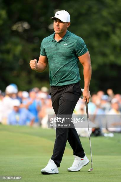 Brooks Koepka of the USA celebrates his birdie putt on the par three 16t hole during the final round of the 2018 PGA Championship at Bellerive Golf...
