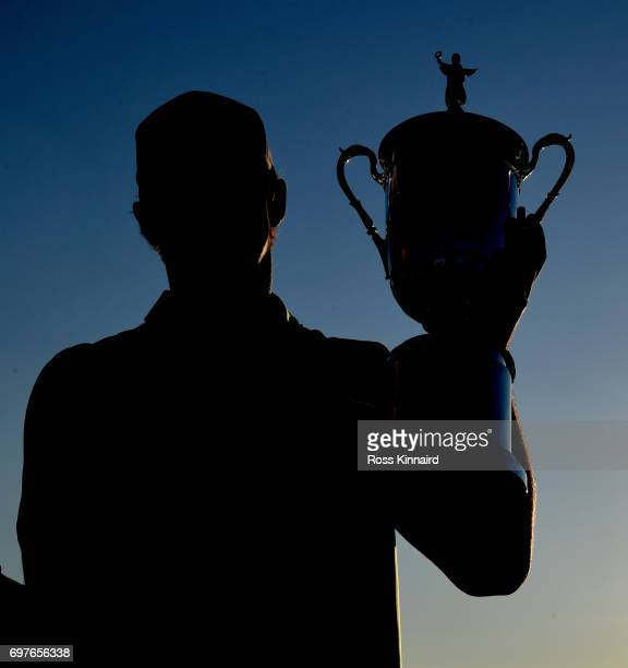 Brooks Koepka of the USA celebrates with the champions trophy after the final round of the 2017 US Open at Erin Hills golf club in Hartford Wisconsin...