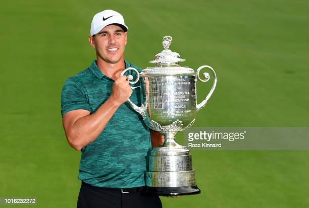 Brooks Koepka of the USA celebrates with the winners trophy on the 18th green after winning the 2018 PGA Championship at Bellerive Golf Country Club...