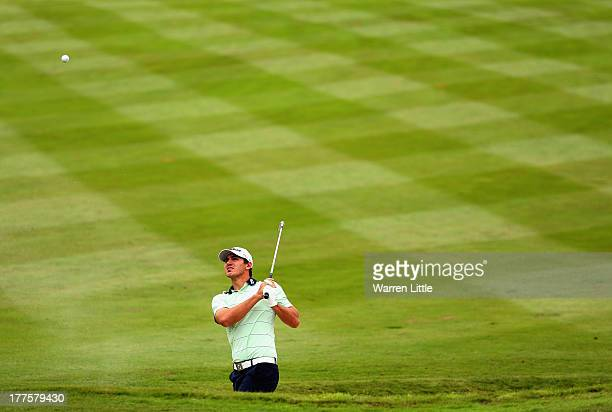 Brooks Koepka of the USA hits the lip of the seventh fairway bunker during the third round of the Johnnie Walker Championship at Gleneagles on August...
