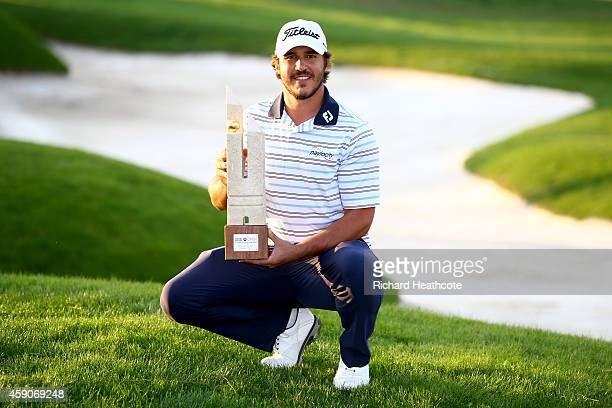 Brooks Koepka of the USA poses with the trophy after securing victory in the final round of the 2014 Turkish Airlines Open at The Montgomerie Maxx...