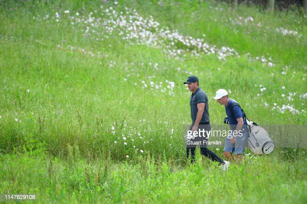 Brooks Koepka of USA walks with his caddie during practice prior to the start of the AT&T Byron Nelson on May 07, 2019 in Irving, Texas.