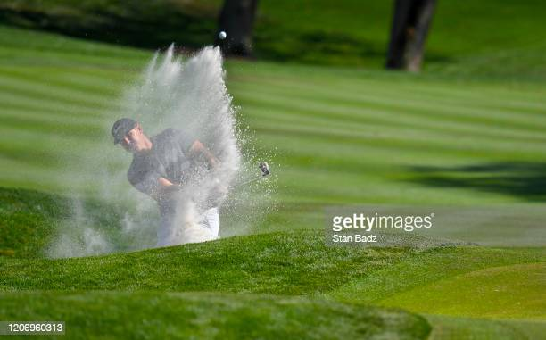 Brooks Koepka plays a bunker shot on the ninth hole during the first round of THE PLAYERS Championship on THE PLAYERS Stadium Course at TPC Sawgrass...