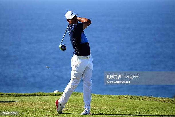 Brooks Koepka plays his shot from the 13th tee during the final round of the Hyundai Tournament of Champions at the Plantation Course at Kapalua Golf...