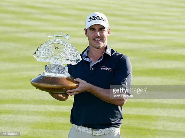 Brooks Koepka poses with the trophy after winning the Waste Management Phoenix Open at TPC Scottsdale on February 1 2015 in Scottsdale Arizona