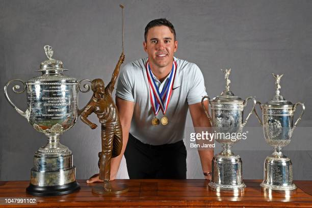 Brooks Koepka poses with the Wanamaker trophy, Player of the Year trophy and the US Open trophies during the Player of the Year ceremony at The...