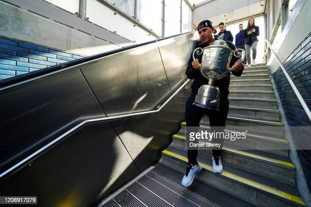 Brooks Koepka walks into the 19th Street BART Station with the Wanamaker Trophy on February 17, 2020 in Oakland, California.