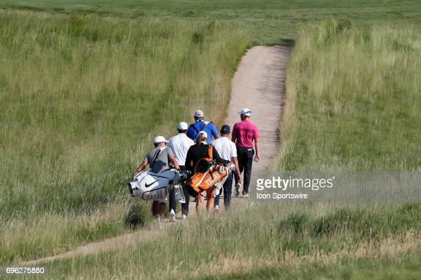 Brooks Koepka walks the 10th hole with a group of players during a practice round for the 117th US Open at Erin Hills in Erin Wisconsin