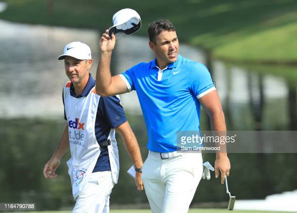 Brooks Koepka waves to the gallery on the 18th hole after winning the World Golf Championship-FedEx St Jude Invitational at TPC Southwind on July 28,...