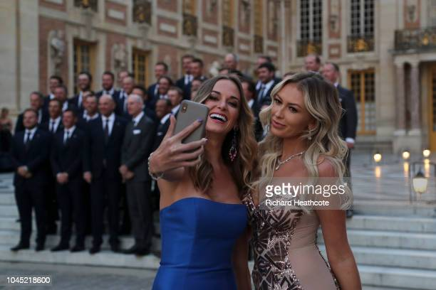 Brooks Koepka's partner Jena Sims takes a selfie with Dustin Johnson's partner Paulina Gretzky before the Ryder Cup gala dinner at the Palace of...