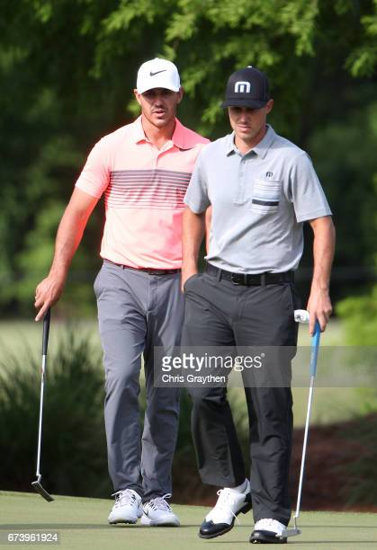 Brooks Kopeka and Chase Koepka on the 12th green during the first round of the Zurich Classic at TPC Louisiana on April 27 2017 in Avondale Louisiana
