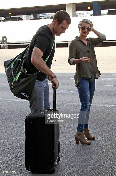 Brooks Laich and Julianne Hough seen at Los Angeles International Airport on February 18 2014 in Los Angeles California