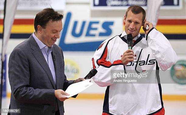 Brooks Laich of the Washington Capitals and sports journalist Elliotte Friedman laugh during the NHL Player QA at the Stirling and District...