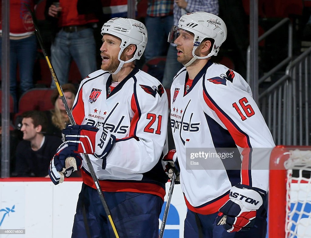 Brooks Laich #21 of the Washington Capitals celebrates his empty net goal with teammate Eric Fehr #16 in the third period against the New Jersey Devils on December 6, 2014 at the Prudential Center in Newark, New Jersey.The Washington Capitals defeated the New Jersey Devils 4-1.