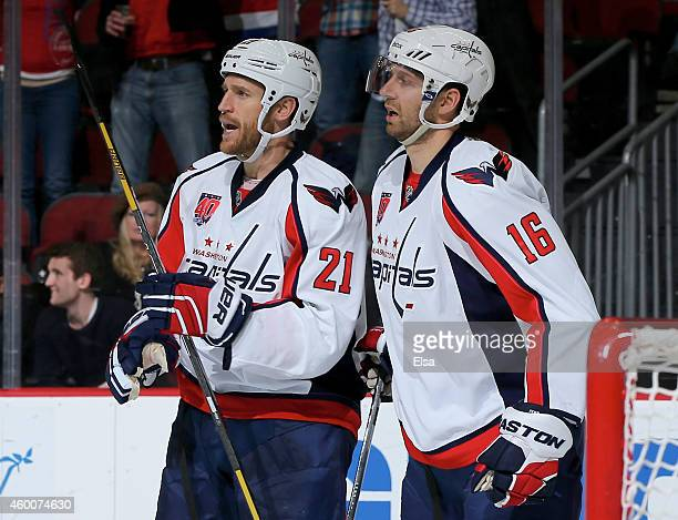 Brooks Laich of the Washington Capitals celebrates his empty net goal with teammate Eric Fehr in the third period against the New Jersey Devils on...