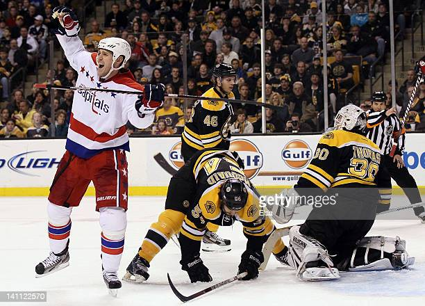 Brooks Laich of the Washington Capitals celebrates his goal in the second period as Adam McQuaidTim Thomas and David Krejci of the Boston Bruins...