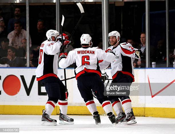 Brooks Laich of the Washington Capitals celebrates with teammates Troy Brouwer and Dennis Wideman after scoring a goal in the second period against...