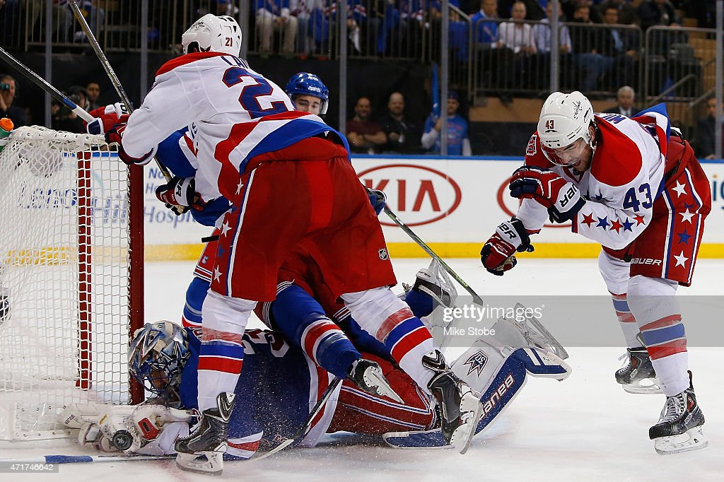 Brooks Laich #21 of the Washington Capitals collides with Henrik Lundqvist #30 of the New York Rangers in Game One of the Eastern Conference Semifinals during the 2015 NHL Stanley Cup Playoffs at Madison Square Garden on April 30, 2015 in New York City. Capitals defeated the Rangers 2-1.