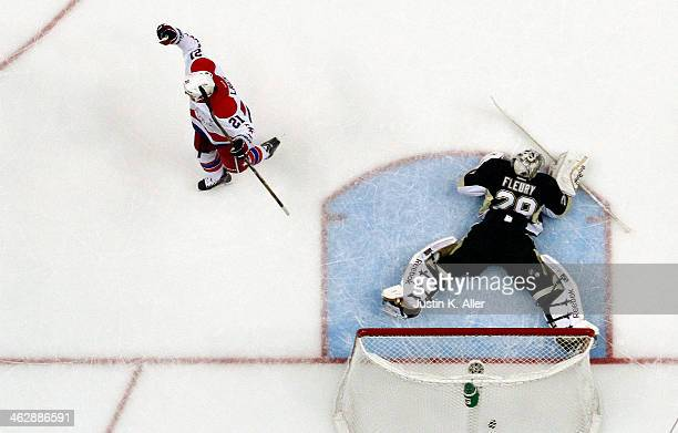 Brooks Laich of the Washington Capitals scores a short handed goal against MarcAndre Fleury of the Pittsburgh Penguins in the first period during the...