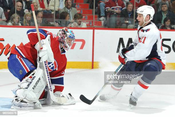 Brooks Laich of the Washington Capitals takes a shot on goalie Carey Price of the Montreal Canadiens in Game Four of the Eastern Conference...