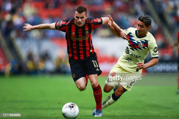 Brooks Lennon of Atlanta United struggles for the ball against Luis Fuentes of America during a quarter final first leg match between Club America...