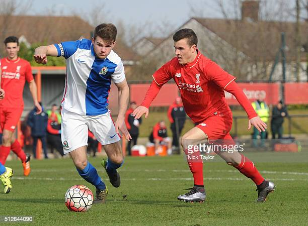 Brooks Lennon of Liverpool and Matthew Platt of Blackburn Rovers in action during the Liverpool v Blackburn Rovers U18 Premier League game at the...