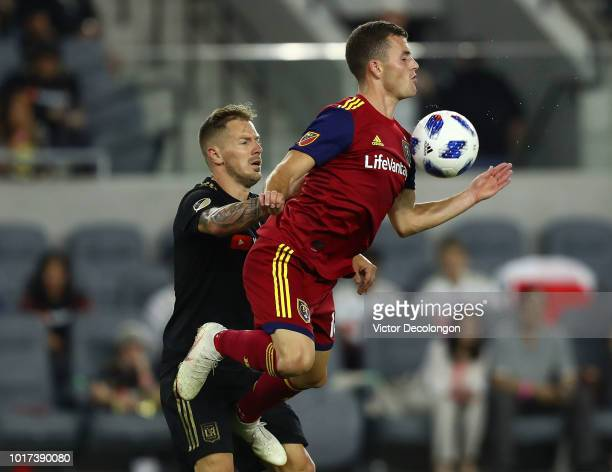 Brooks Lennon of Real Salt Lake wins the high ball from Jordan Harvey of Los Angeles FC during the second half of their MLS match at Banc of...